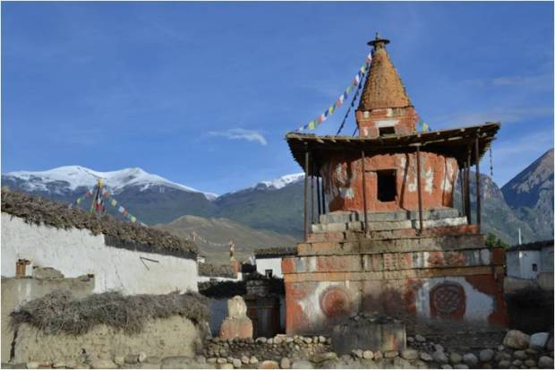 Chorten and snow capped peaks